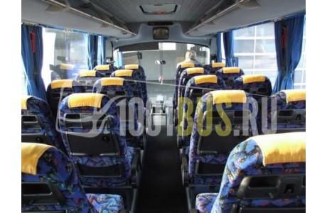 Аренда Автобус Neoplan 316 - фото сбоку