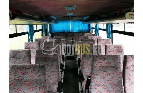 Аренда Автобус Mitsubishi Starix - фото сбоку
